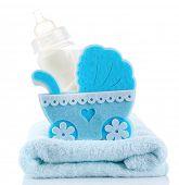 Blue little pram and bottle of milk isolated on white