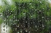 stock photo of rain  - Drops of rain on glass surface rain drop dripping down - JPG