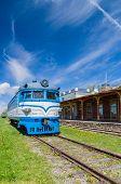 stock photo of locomotive  - Railway station museum building and locomotive Haapsalu Estonia - JPG