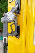 stock photo of dispenser  - old fuel nozzle dispenser for adding gasoline - JPG