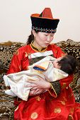 Mongolian Woman And Baby
