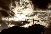 stock photo of construction crane  - Construction Site and Crane Silhouette sunset construction - JPG