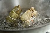image of chinese wok  - Zongzi boiling in a wok - JPG
