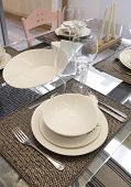 picture of crockery  - Crockery set over a table ready to be served - JPG