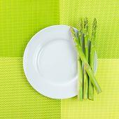 image of bundle  - Bundle of fresh asparagus on white plate - JPG