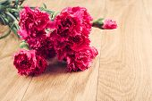 stock photo of carnation  - Pink carnations flower bouquet on rustic wooden background - JPG