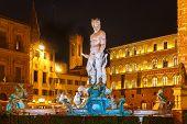 foto of piazza  - Fountain of Neptune by Bartolomeo Ammannati on  Piazza della Signoria in Florence at night - JPG