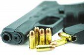 stock photo of 9mm  - 9mm bullets and black gun pistol isolated on white background - JPG