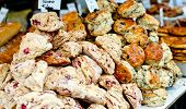 pic of baked raisin cookies  - Just baked butterscotch and cranberry scones on sale at local farm market - JPG