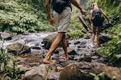 Couple Crossing The Stream Barefooted poster