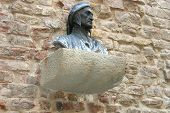 stock photo of alighieri  - Bust Dante Alighieri on a facade of its house in Florence - JPG