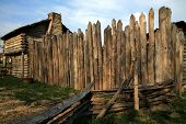 picture of stockade  - The Stockade wall butted up against the blockhouse of the Mansker station Replica - JPG