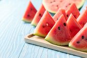 Slice Of Watermelon On Blue Wood Background, Fruit In Summer Concept poster