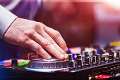 Closeup Hands Of Disk Jockey At The Dj Controller Wearing In White Shirt At Night Club. Edm, Party C poster