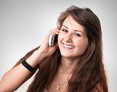 Cute businesslike woman secretary talking on phone