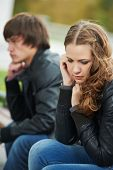 problem depression relationship difficulties of young couple people outdoors