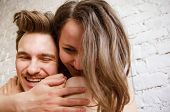 Happy Half-nude Loving Couple Hugging Against A Brick Wall Background. Close-up. poster