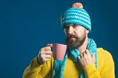 Bearded Man Warming Up With Hot Tea In Winter Time. Stylish Man With Beard And Mustache Drinking Hot poster