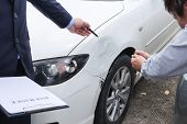 Insurance Agent Examine Damaged Car And Filing Report Claim Form After Accident, Traffic Accident An poster