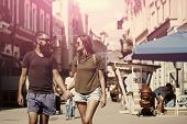 Couple Secrets Fantasy. Fashion, Urban Style, Lifestyle. Sexy Woman And Bearded Man Hold Hands On St poster