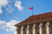 Czech Flag In The Wind On The Roof Of Ministry Of Foreign Affairs In Prague, Czech Republic. Blue Sk poster