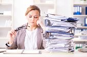 Businesswoman very busy with ongoing paperwork poster