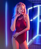 Fashion Art Photo Of Elegant Model In Seductive Red Swimsuit With Light Neon Colored Club Spotlights poster