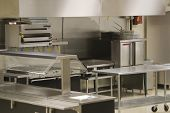 stock photo of convection  - A look into a stainless steel restaurant kitchen - JPG