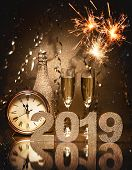 New Years Eve celebration background with pair of flutes, bottle of champagne and a clock poster