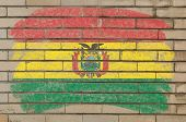 Flag Of Bolivia On Grunge Brick Wall Painted With Chalk