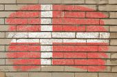 Flag Of Denmark On Grunge Brick Wall Painted With Chalk