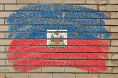 Flag Of Haiti On Grunge Brick Wall Painted With Chalk