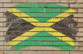 picture of jamaican flag  - Chalky jamaican flag painted with color chalk on grunge old brick wall - JPG