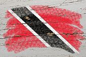 Flag Of Trinidad And Tobago On Grunge Wooden Texture Painted With Chalk