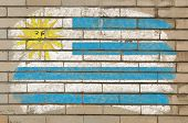 Flag Of Uruguay On Grunge Brick Wall Painted With Chalk