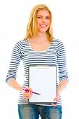 Smiling Teen Girl With Clipboard And Pen For Signing