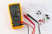 stock photo of ohm  - a true rms multimeter and a circuit diagram - JPG