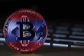 Постер, плакат: Bitcoin Close up On Keyboard Background The Flag Of Guam Is Shown On Bitcoin
