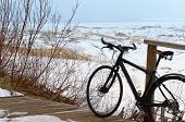 Black Touring Bike Amid The Misty Sand Dunes, Black Bike On Top Of A Hill, A Bike High On A Sand Dun poster