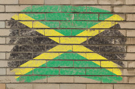 stock photo of jamaican flag  - Chalky jamaican flag painted with color chalk on grunge old brick wall - JPG