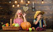Kids Farmers Girl Boy Vegetables Harvest. Family Farm. Children Presenting Farm Harvest Wooden Backg poster