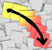 An arrow pointing downward drawn on yellow and red sticky notes, illustrating failure, negative move