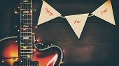Old, Jazz Electric Guitar With A Luminous Garland. New Year Greeting Card For Musician, Guitarist. F poster