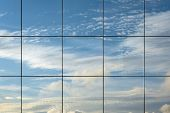 Sky Reflection In Modern Skyscraper Window. Cloudscape View Reflected In Futuristic Architectural St poster