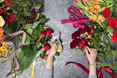 Florist Creates A Bouquet In A Flower Shop. Top View Of Creating A Bouquet Of Red, Orange, Burgundy, poster