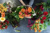 The Concept Of Gifts And Bouquets For March 8 And Mothers Day. Florist Creates A Bouquet In A Flower poster