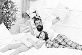 Funny Pajama Party. Small Girl With Bearded Father In Bed. Weekend At Home. Happy Fatherhood. Father poster