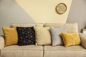 Modern Comfortable Sofa With Pillows Indoors. Stylish Room Interior poster