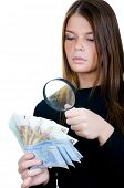 Woman with magnifying glass and euro banknote