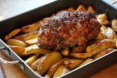 Roast Of Lamb With Potatoes